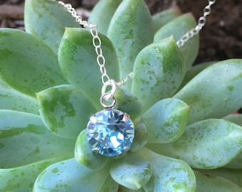 Sterling silver Necklace with aquamarine Swarovski pendent.
