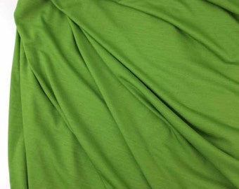 Lightweight wool and lycra jersey fabric in lily green, sewing fabric, by the yard.