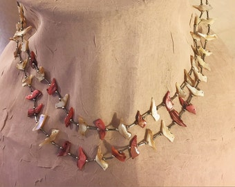 Vintage Zuni liquid silver and bird fetish two strand necklace. Beautifully matched hand carved colored shell fetish.