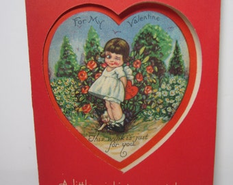 1920's-30's adorable die cut heart window valentine card shows big eyed little girl winking and her puppy winking at her feet in a garden