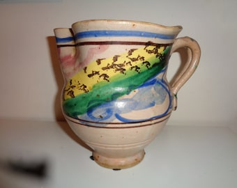 Retro Rustic Hand Made Ceramic Clay Pitcher with a great handle that has a wonderful whimsical glazed finished design in Very Good Condition