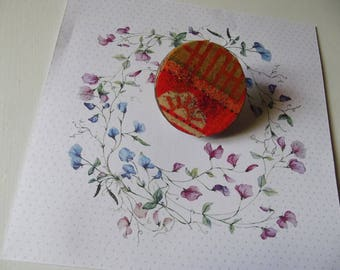 orange and gold wooden brooch