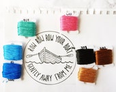 """custom """"row row row your boat"""" embroidered patch on piece of linen"""