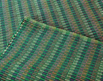 Handwoven green cotton rug