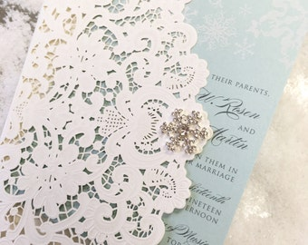 Fully customizable laser cut winter wedding invitation with rhinestone snowflake bling and white ink printing