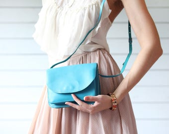 Vintage bright blue leather small cross body shoulder clutch bag