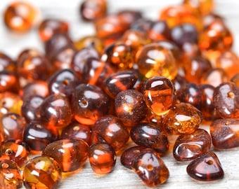 6-8 millimeters Baltic amber beads. 50 Pcs.
