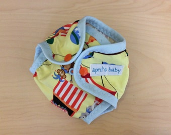Newborn waterproof cloth diaper cover - fits 6-12 lbs, at the circus