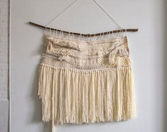 large neutral woven wall hanging long fringe rope accent off white roving