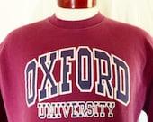 vintage 80's 90's Oxford University graphic sweatshirt burgundy red fleece navy blue white puffy print curve logo crew neck oversized Medium