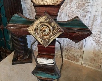 Patchwork wood cross designed with architectural salvage
