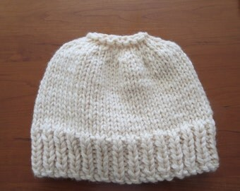 Hand knit woman's off white 100% thick wool pony tail or messy bun hat