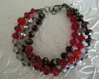Sparkling red, black and silver multi strand bracelet