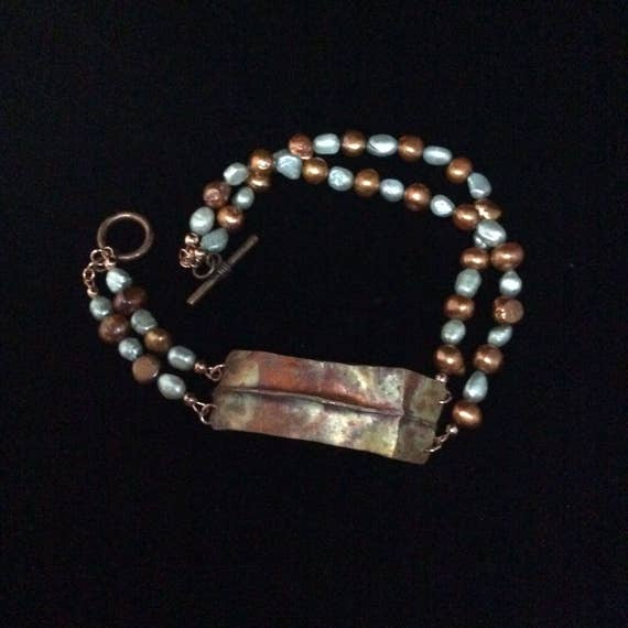 Religious fold formed copper pearl beaded wrap bracelet