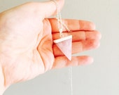 Rose quartz triangle crystal necklace on a sterling silver chain.
