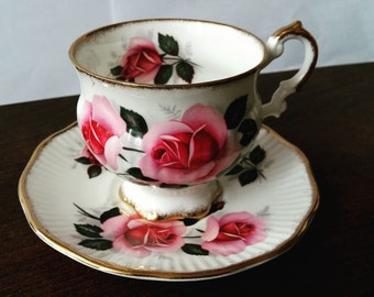 Elizabethan Teacup and Saucer with lovely pink roses and golden rim