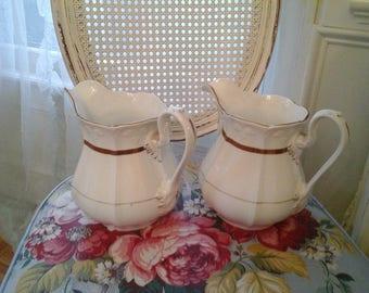 Pair of vintage pitchers
