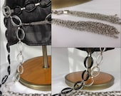 """80s Chain Belts - Two Plastic and Silver metal Link Belts from the 80s or 70s w chain tassels Good Size 60"""" total 150 cm)One Black one clear"""