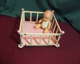 Little Doll In Small Size Playpen . Baby Doll Playpen With Doll