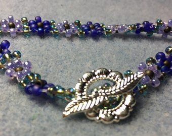 "Very cute chain of daisy's bracelet, flowers are Cobalt Blue and Lavender.  Bracelet is 7"", all Miyuki Beads"