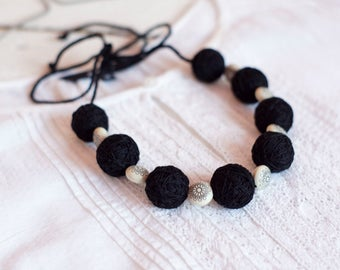 Black long necklace beads of a thread cotton summer textile girls