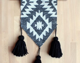 black and white aztec or southwestern wall hanging with tassels