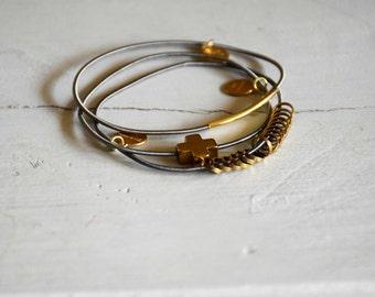 Gri-gri gray and gold eternity bracelet cross, tube rings on spring