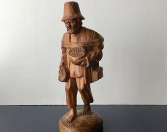 vintage carved wood man walking traveling man hobo peasant