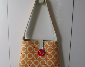 Lovely ladies or girls handbag fully lined with beautiful red button