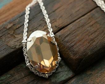 Swarovski Golden Shadow Crystal Cradle Pendant in Sterling Silver