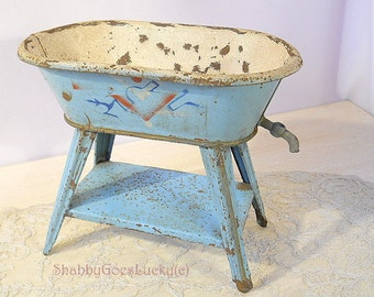 Antique doll bathtub made of lithographed tin, standing on legs, non-working faucet, 1920s German dollhouse bathroom furniture