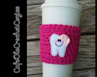 Crochet coffee cup cozy, with a tooth feltie, made with 100% cotton. Crochet coffee sleeve, crochet coffee cozie