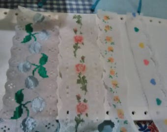 Lot of 4 eyelet lace trim. Approximately 3 have 5 yards each.  1 has 3 yards. 4 different patterns.
