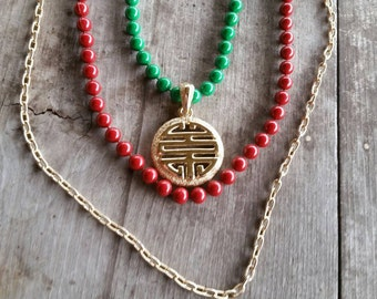 Sarah Coventry Asian Medallion Three Strand Red Green and Gold Necklace