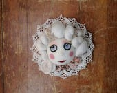 Marie Antoinette doll head to hang on the wall