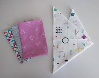 Geometric set of 4 unique napkins. Pink, grey and blue.