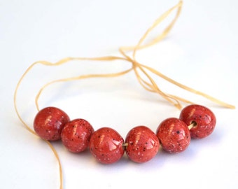 Handmade Ceramic Beads Round in Deep Red with Tiny Black Speckles and white Spots