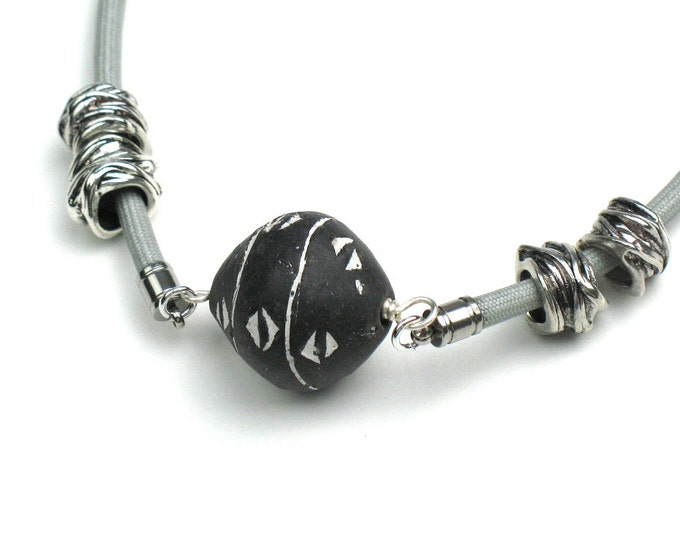 Cord Necklace in Grey with Large African Fair Trade Bead and Silver Textured Tube Beads
