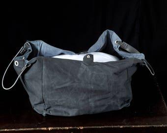 Black wax canvas tote bag, cotton handbag leather handles, zipper pockets, striped cotton denim lining, large capacity, elegant design.