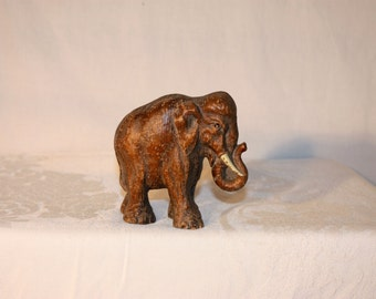 """Heavy composition old elephant figure 4.5"""" tall and almost 5"""" long"""