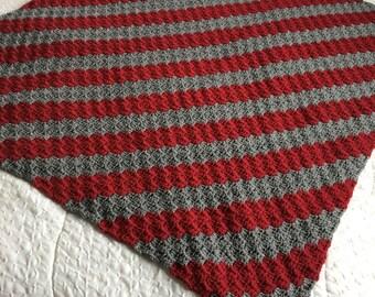 Crocheted lap afghan in greys and burgandy