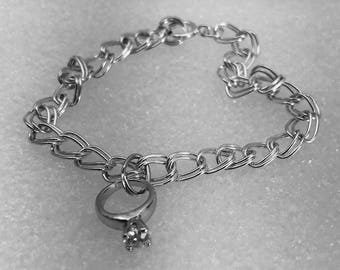 Sterling silver charm bracelet with engagement ring charm.