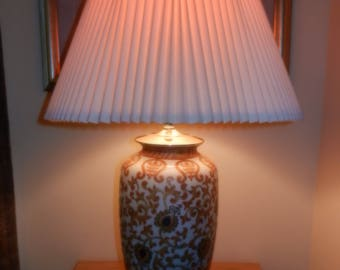 This Large Porcelain TEMPLE JAR Lamp comes with a Corrugated Spider Shade