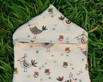 A peg bag with a chickens designs.  Peg storage.