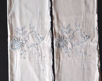 White Linen Pillow Cases With Powder Blue Embroidered Flower and Leaf