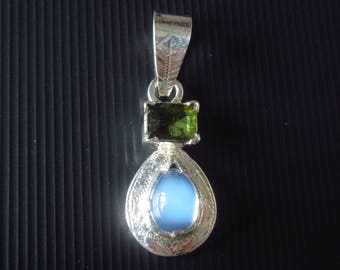3.70 Ct. Amazing & rare Burmese Blue Monstone + 1.65 ct. yellowish green rare Burmese Tourmaline, sterling silver pendent. Lab. certified.