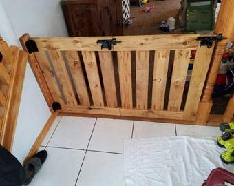 Folding traditional baby or pet gate.