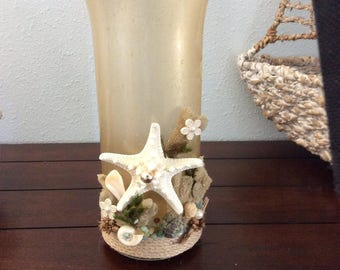 Iridescent gold sea shell candle holder