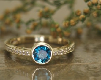 Kylee -London Blue Topaz and Diamond Engagement Ring in yellow Gold, Bezel Set Round Brilliant Center with Channel Set Accents Free Shipping