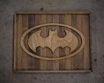 handcrafted batman symbol from salvaged wood